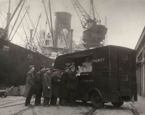 Photograph of mobile canteen dispensing food on the London docks during WWII, copyright PLA Archive/Museum of London.
